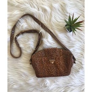 Embossed cross body bag